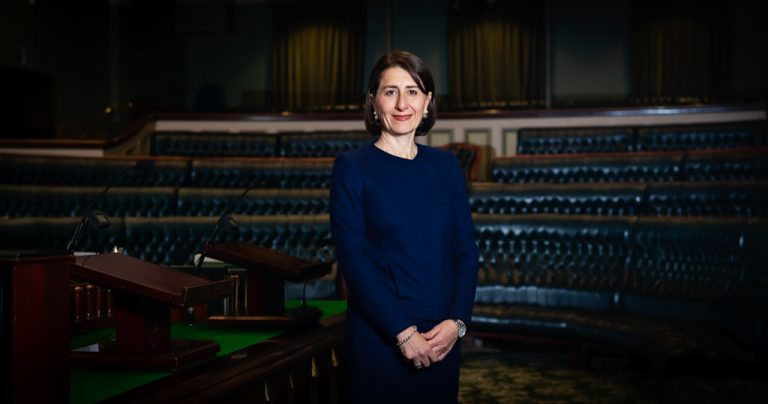 Portrait of former NSW Premier Gladys Berejiklian standing in the lower house chamber of parliament